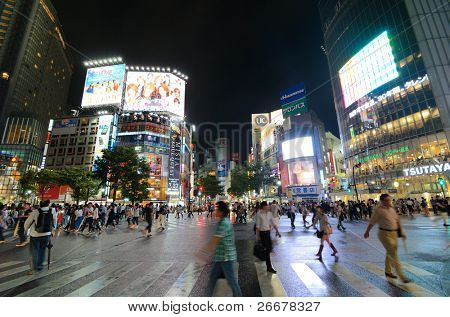TOKYO, JAPAN - JULY 19: Shibuya crossing is one of the largest and most famed examples of a scramble crosswalk in the world on July 19, 2011 in Tokyo, Japan.