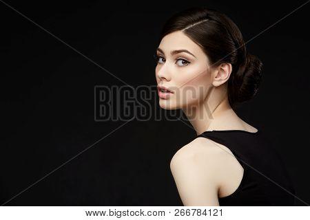 Beautiful Girl With Hairdo On Balck Background
