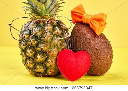 a57121d4c33a Funny Pineapple In Glasses And Coconut. Couple Of Exotic Fruits Wearing  Eyeglasses And Hairbow On