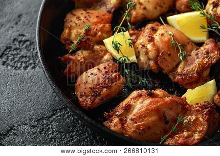 Roasted Boneless Skinless Chicken Thighs In Lemon And Thyme Dressing Served In Vintage Cast Iron Ski