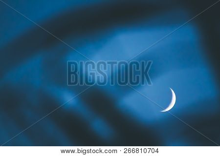 Moon's Crescent Phase Against A Black Night Sky