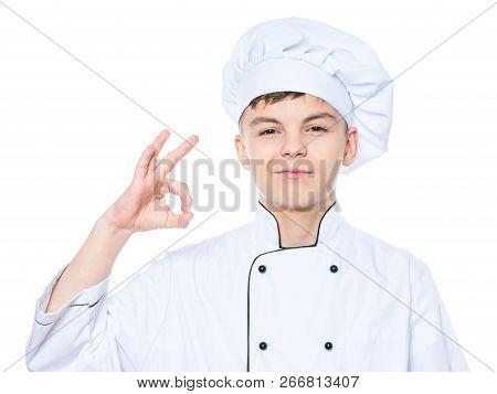 Handsome Teen Boy Wearing Chef Uniform Making Ok Gesture. Portrait Of A Happy Cute Male Child Cook,