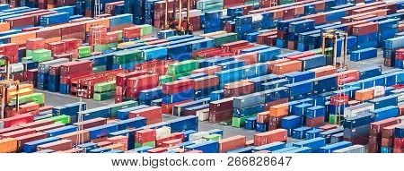 Texture Made With An Aerial View Over Shipping Cargo Containers Stacked On A Commercial Port. Suitab