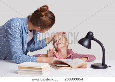 Lovely Woman Keeps Hand On Daughters Forehead, Praises And Encourgae Her For Studying Well, Pose At