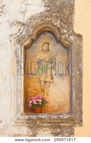 Presicce, Apulia, Italy - An Old Religious Wall Painting In The Streets Of Presicce