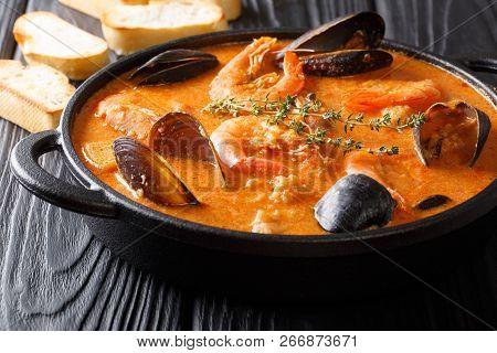 Catalan Authentic Spicy Suquet De Peix Soup With Potatoes, Shrimps, Mussels, Herbs And Fish With Pic