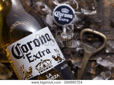 London, Uk - April 27, 2018: Glass Bottle Of Corona Extra Beer On Wooden Background With Bottle Open