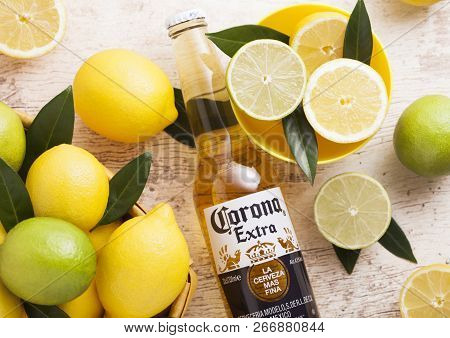 London, Uk - April 27, 2018: Glass Bottle Of Corona Extra Beer On Wooden Background With Fresh Lemon