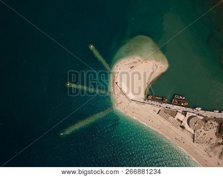 Port And Jetty, Sandy Peninsula With Old, Rusty Ships, Birds Eye View Above Lefkada, Greece