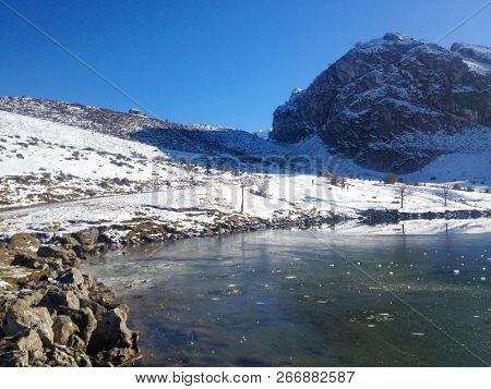 View Of Enol Lake In Winter. Mountains Of Picos De Europa National Park, Asturias, Spain.