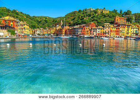 Beautiful Portofino Cityscape, Best Touristic Mediterranean Place With Typical Colorful Buildings An