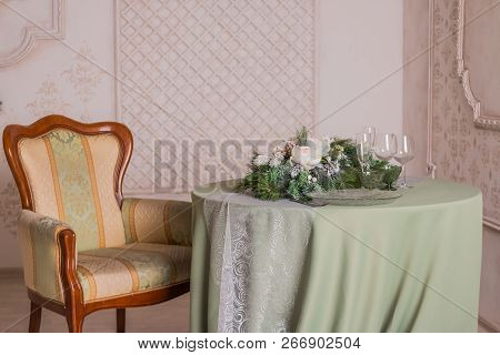 Cozy Festive Table With Candles, Wineglasses And Plates. Romantic Dinner. Vintage Chair.elegant Tabl