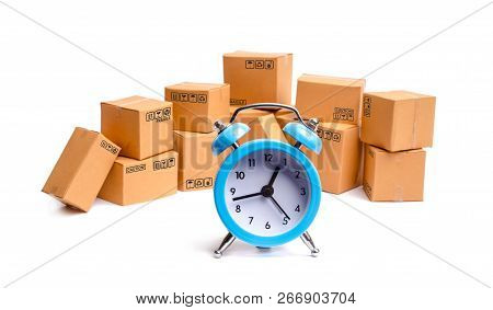 Cardboard Boxes And Clock On White Background. Time Of Delivery. Concept Of Buying And Selling Goods