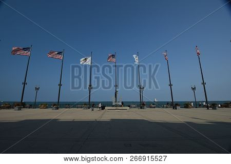 A Row Of Flags Flying On Flag Poles Including The United States Of America National Flag, The City O