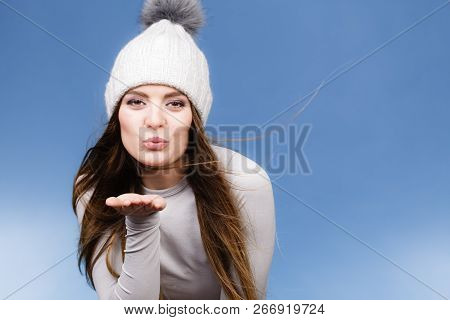 Attractive Woman In Winter Cap And Gray Sports Thermolinen Underwear For Skiing Training Studio Shot