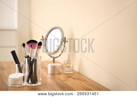 Makeup Cosmetic Products With Tools In Organizer On Dressing Table. Space For Text