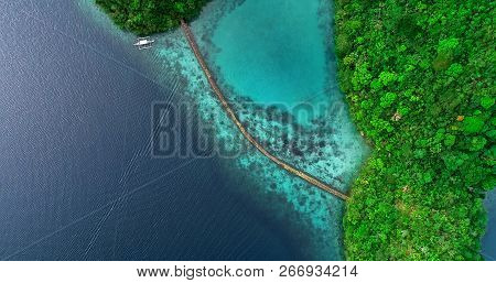 Aerial View Of Sugba Lagoon. Beautiful Landscape With Blue Sea Lagoon And Bridge, National Park, Sia
