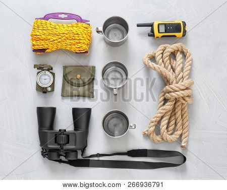 Flat Lay Composition With Camping Equipment On Grey Background