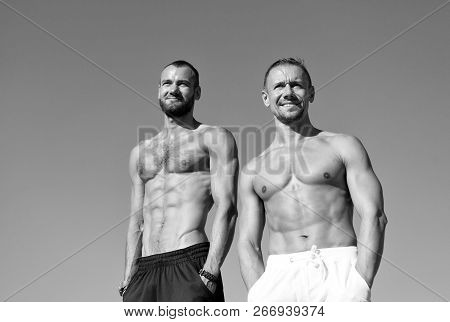 Men Muscular Body Posing Confidently With Hands In Pockets. Sportsmen Muscular Belly Posing. Sport A