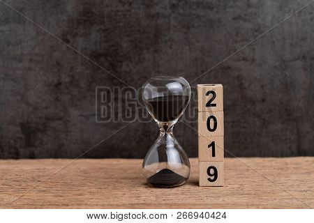 New Year 2019 Time Countdown Or Business Goals Concept, Hourglass Or Sandglass And Stack Of Cube Woo
