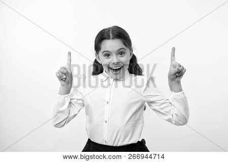 Little Genius Has An Idea. Happy Girl Keep Fingers Raised On Yellow Background. Back To School. Litt