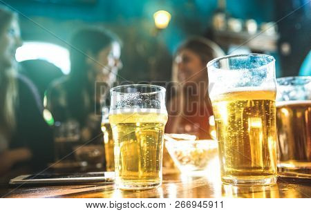 Happy Girlfriends Women Group Drinking Beer At Brewery Bar Restaurant - Friendship Concept With Youn