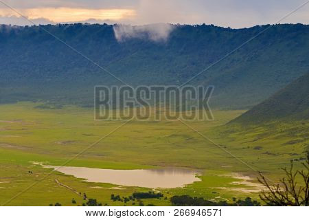 Scenic morning view of Lake Magadi, seasonal salt lake, also called Makat, center of Ngorongoro Crater Conservation Area, view from edge of crater in Tanzania, East Africa