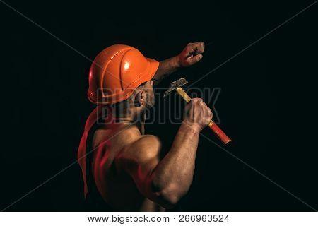 Still Under Construction. Hard Worker Use Muscular Strength. Man Work With Hammer. Construction Work