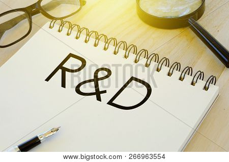 Business And Finance Conceptual. Sunglasses,pen,magnifying Glass And Notebook Written With R&d (rese