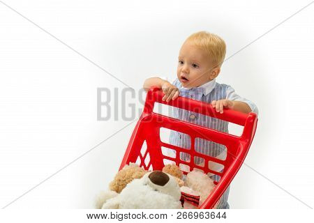 Happy Childhood And Care. Shopping For Children. Little Boy Child In Toy Shop. Savings On Purchases.