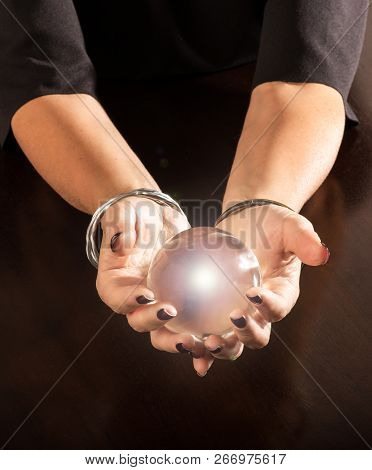 Fortune Teller Holding A Crystal Ball In Her Hands