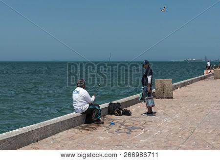 Fisherman On The Fishermans Wharf In Progreso, Muelle De Pescadores, Yucatan, Mexico