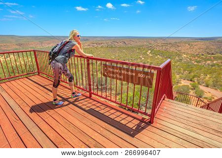 Blonde Caucasian Woman Enjoys Views With Blue Sky Of The Gorge From Beginning Trail To Popular Natur