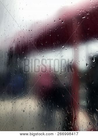 Blurry View From The Steamy Window On A Bus Stop On A Rainy Day That Brings Sadness.