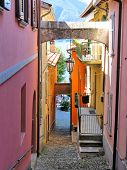 Narrow street of Varenna town at the lake Como, Italy poster