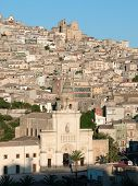 view of the houses and the churches on the hill on which stands the village of Agira in Sicily poster