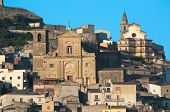 churches on the hill on which stands the village of Agira in Sicily poster