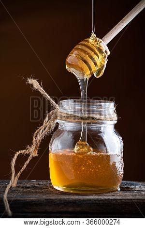 Honey Drizzling. Serving Honey Of A Pot.