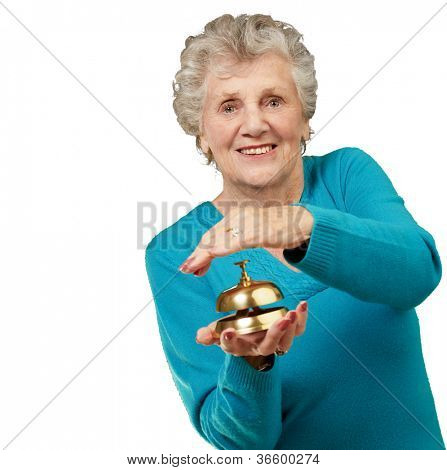 Happy Mature Woman While Holding Bell On White Background poster