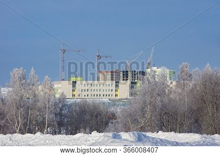Winter Construction With Tower Cranes Of New Area The Edge Of The City, Cables And Forest Covered Wi