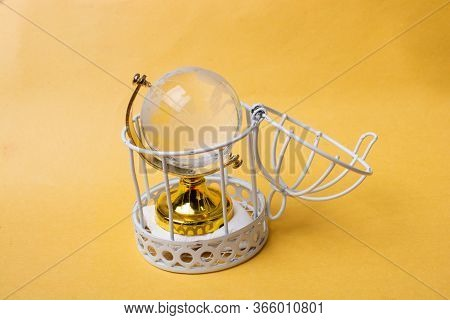 Globe In Cage As Global Quarantine During The Covid-19 Concept