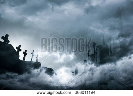 Cemetery Or Graveyard In The Night With Dark Sky And White Clouds. Haunted Cemetery. Spooky And Scar
