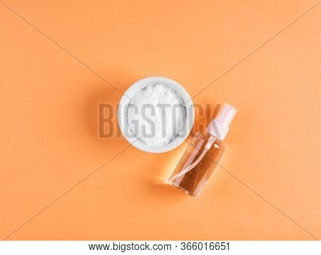 Baking Soda In Bowl On Orange Background. Concept Of Baking Soda As Multi Use Cleaning Or Beauty Ing