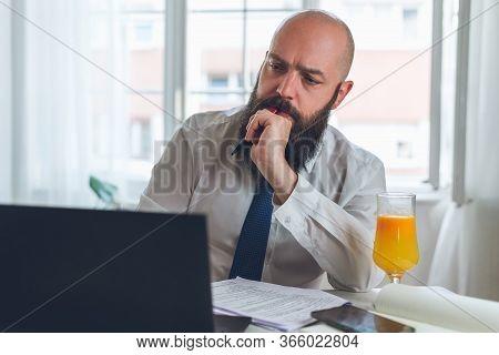 Bearded Businessman Portrait In Office. Businessman Face Portrait. Businessman Portrait Working On C