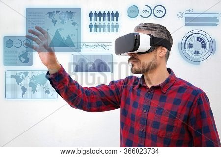 Concentrated Man In Vr Headset Touching Virtual Data Analysis. Handsome Focused Bearded Men Checkere