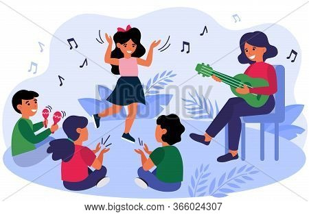 Happy Kids Having Fun During Their Music Class. Teacher And Children Playing Guitar, Clapping Hands,