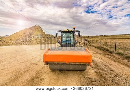 Steamroller Performing Earth Compaction Work For Later Asphalting
