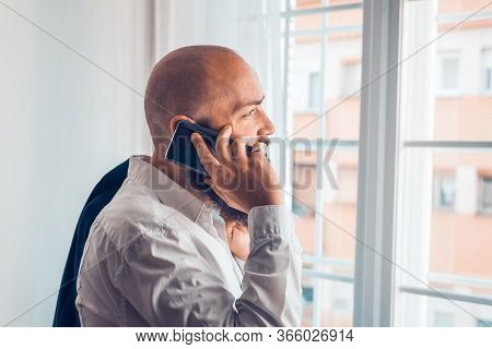 Businessman Portrait With Cellphone. Businessman Portrait While Speaking On Cellphone. Businessman P