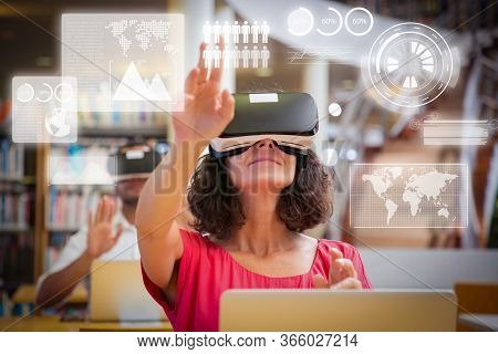 Adult Students Using Vr Simulators For Virtual Statistics For Studying. Man And Woman In Virtual Rea