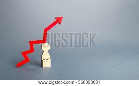 Figurine Man With A Crack And A Red Down Arrow Up. The Growth Of Seriously Ill People, Critical Case